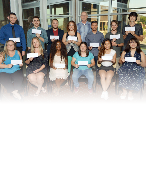 Image of Students with Scholarship Checks